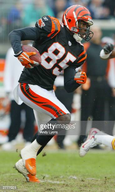 Wide receiver Chad Johnson of the Cincinnati Bengals carries the ball against the Kansas City Chiefs during the game at Paul Brown Stadium on...