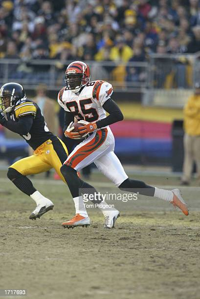 Wide receiver Chad Johnson of the Cincinnati Bengals gains yards during the NFL game against the Pittsburgh Steelers at Heinz Field on November 24...