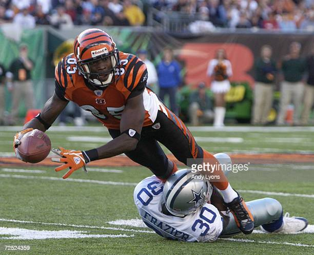 Wide receiver Chad Johnson of the Cincinnati Bengals is tackled by cornerback Lance Frazier of the Dallas Cowboys during the game at Paul Brown...