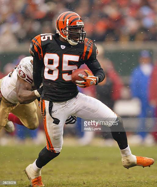 Wide receiver Chad Johnson of the Cincinnati Bengals runs the ball after a catch during the game against the San Francisco 49ers on December 14 2003...