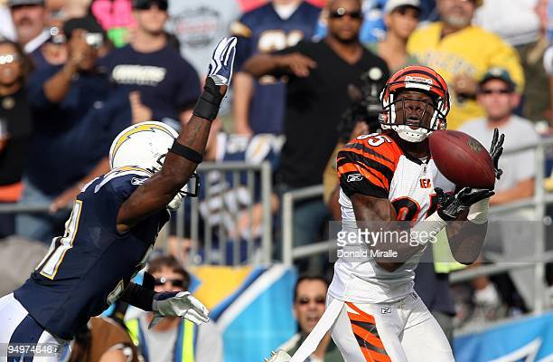 Wide Receiver Chad Ochocinco of the Cincinnati Bengals catches a pass to score a touchdown in the first half against Antonio Cromartie of the San...