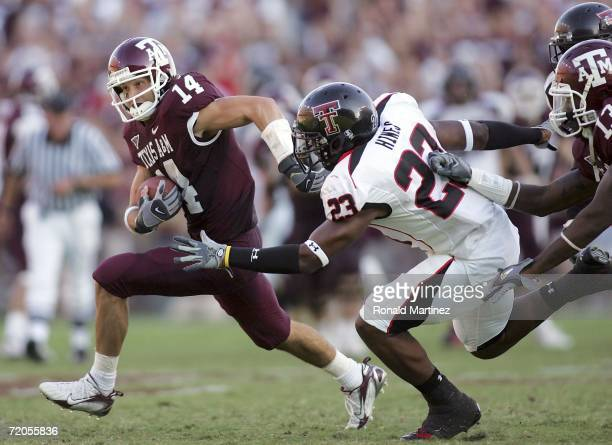Wide receiver Chad Schroeder of the Texas AM Aggies runs past Anthony Hines of the Texas Tech Red Raiders at Kyle Field on September 30 2006 in...