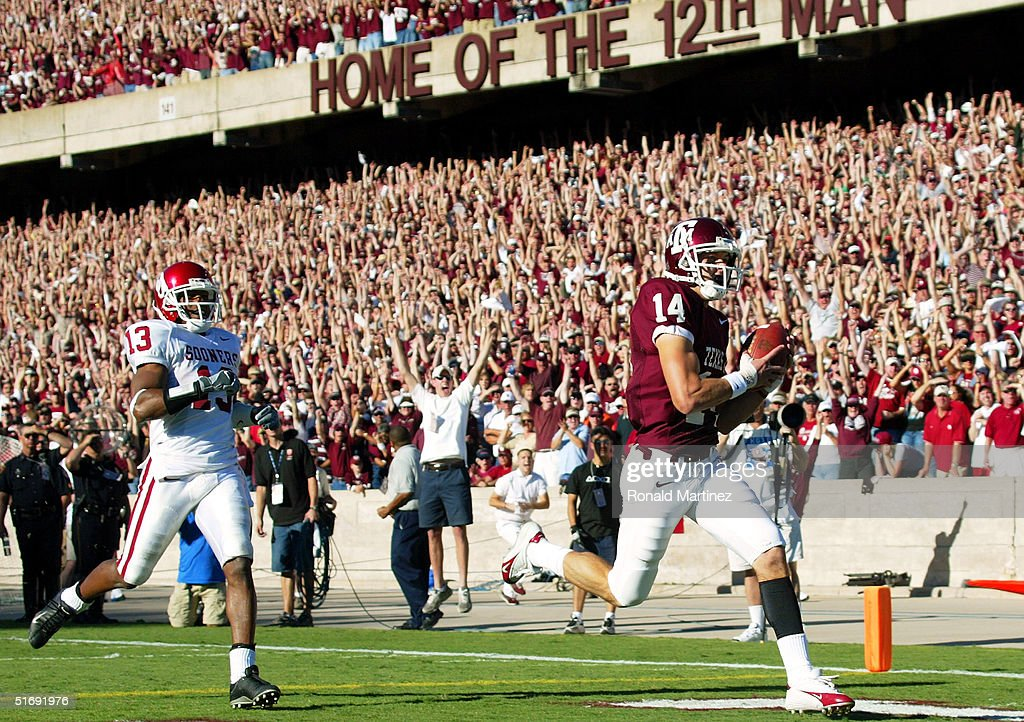 Wide receiver Chad Schroeder #14 of the Texas A&M University Aggies makes a touchdown pass reception in front of Eric Bassey #13 of the University of Oklahoma Sooners on November 6, 2004 at Kyle Field in College Station, Texas.