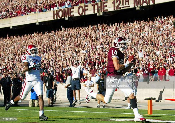 Wide receiver Chad Schroeder of the Texas AM University Aggies makes a touchdown pass reception in front of Eric Bassey of the University of Oklahoma...