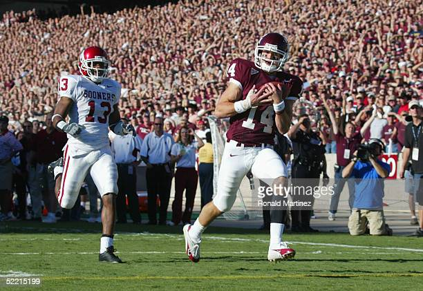 Wide receiver Chad Schroeder of the Texas A&M University Aggies scores a touchdown near defensive back Eric Bassey of the University of Oklahoma...