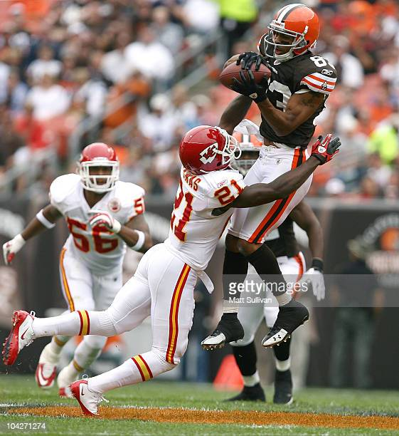 Wide receiver Chansi Stuckey of the Cleveland Browns goes up for a catch over cornerback Javier Arenas of the Kansas City Chiefs at Cleveland Browns...
