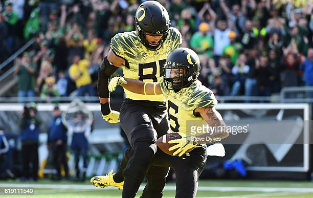 Wide receiver Charles Nelson of the Oregon Ducks celebrates with teammate tight end Pharaoh Brown after catching a touchdown during the first quarter...