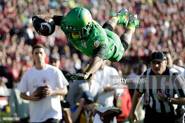 Wide receiver Charles Nelson of the Oregon Ducks dives to the oneyard line in the first quarter of the College Football Playoff Semifinal against the...