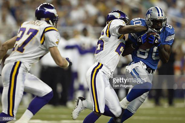 Wide receiver Charles Rogers of the Detroit Lions battles for the ball with cornerback Roderick Babers of the Minnesota Vikings at Ford Field on...