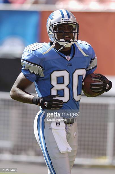 Wide receiver Charles Rogers of the Detroit Lions carries the ball during the NFL preseason game against the Cleveland Browns on August 21 2004 at...
