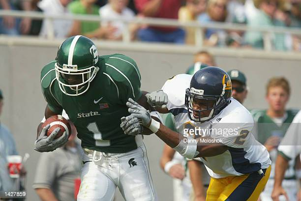 Wide Receiver Charles Rogers of the Michigan State Spartans looks to break free from safety Nnamdi Asomugha of the California Golden Bears on...