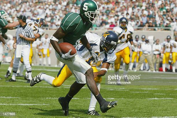 Wide Receiver Charles Rogers of the Michigan State Spartans looks to out run cornerback Jemeel Powell of the California Golden Bears on September 14...