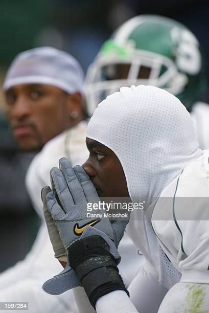 Wide receiver Charles Rogers of the Michigan State Spartans shows his dejection along with teammates BJ Lovett and Ziehl Kavanaght in the final...