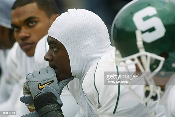 Wide receiver Charles Rogers of the Michigan State Spartans sits on the sidelines against the Michigan Wolverines during the game on November 2 2002...