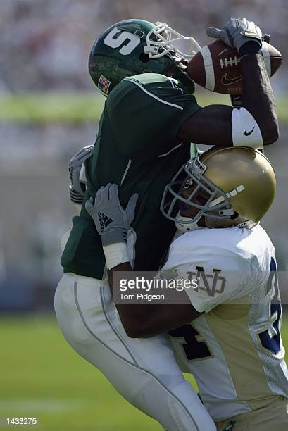 Wide receiver Charles Rogers of the Michigan State University Spartans catches a pass over corner back Vontez Duff of the Notre Dame University...