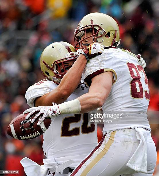 Wide receiver Charlie Callinan of the Boston College Eagles celebrates his touchdown reception with teammate wide receiver David Dudeck against the...