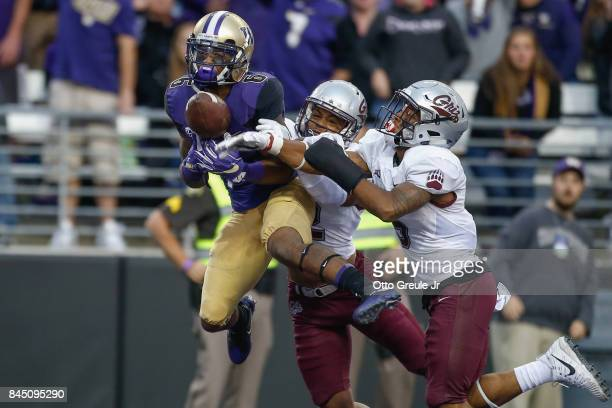 Wide receiver Chico McClatcher of the Washington Huskies has this pass batted away in the end zone by cornerback Ryan McKinley and safety Justin...