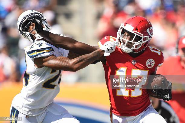 Wide receiver Chris Conley of the Kansas City Chiefs catches the ball for the first down in the third quarter against cornerback Trevor Williams of...
