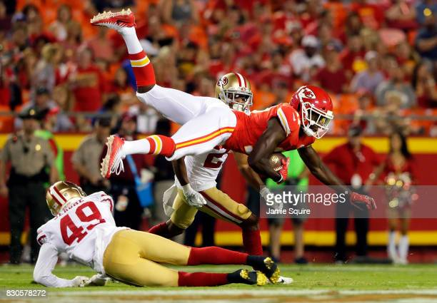 Wide receiver Chris Conley of the Kansas City Chiefs is upended by defensive back Lorenzo Jerome of the San Francisco 49ers after making a catch...