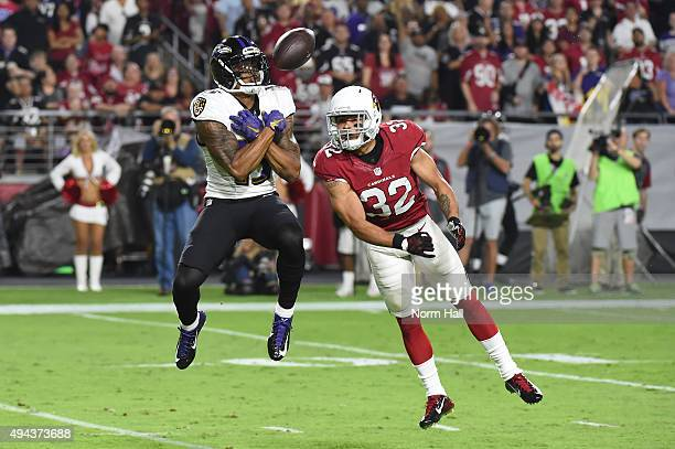 Wide receiver Chris Givens of the Baltimore Ravens is unable to make a catch against free safety Tyrann Mathieu of the Arizona Cardinals in the...