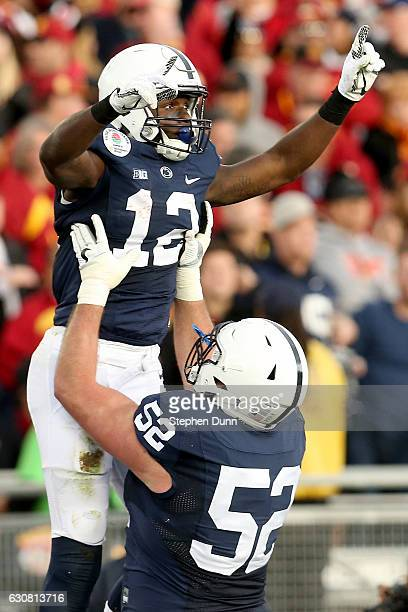 Wide receiver Chris Godwin of the Penn State Nittany Lions celebrates with guard Ryan Bates after catching a 30yard touchdown pass in the second...