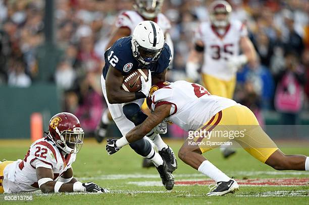 Wide receiver Chris Godwin of the Penn State Nittany Lions is tackled by defensive back Ronald Jones II of the USC Trojans in the first half of the...