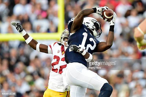 Wide receiver Chris Godwin of the Penn State Nittany Lions makes a reception in the first half as defensive back Leon McQuay III of the USC Trojans...