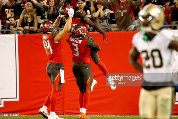Wide receiver Chris Godwin of the Tampa Bay Buccaneers celebrates what would be the gamewinning touchdown with quarterback Jameis Winston and tight...