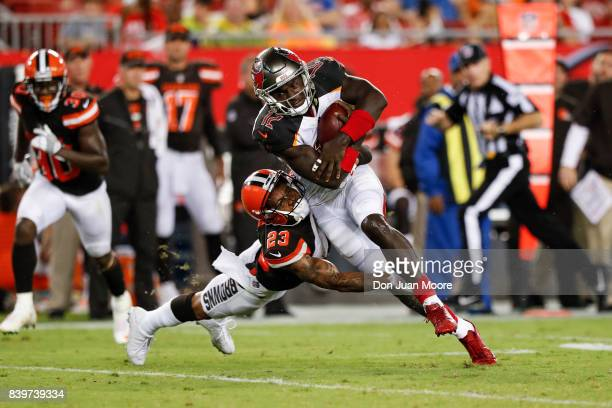 Wide Receiver Chris Godwin of the Tampa Bay Buccaneers makes a catch over Cornerback Joe Haden of the Cleveland Browns during the game at Raymond...