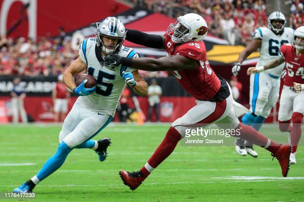 Wide receiver Chris Hogan of the Carolina Panthers carries the ball against linebacker Chandler Jones of the Arizona Cardinals in the first half of...