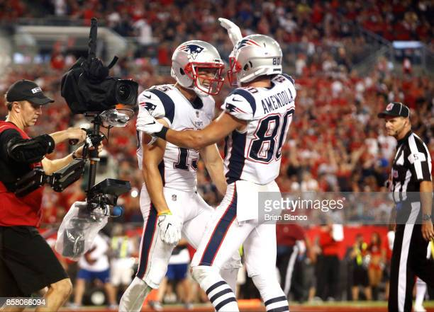 Wide receiver Chris Hogan of the New England Patriots celebrates with wide receiver Danny Amendola hauling in a 5yard touchdown pass from quarterback...