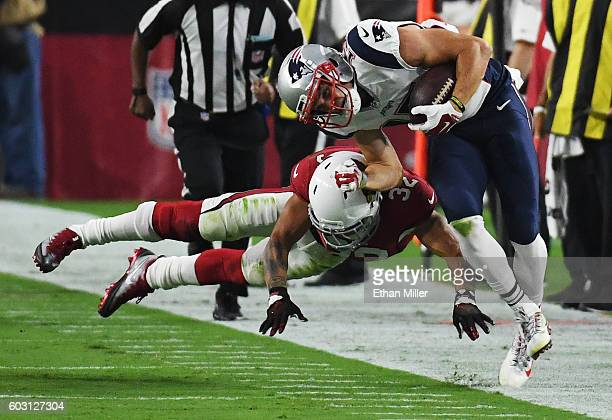 Wide receiver Chris Hogan of the New England Patriots is pushed out of bounds by free safety Tyrann Mathieu of the Arizona Cardinals after picking up...