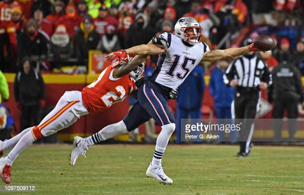 Wide receiver Chris Hogan of the New England Patriots stretches out to make a one handed catch against cornerback Steven Nelson of the Kansas City...