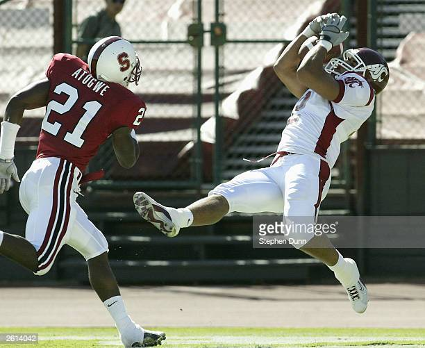 Wide receiver Chris Jordan of the Washington State Cougars makes a touchdown catch on the game's first series as safety Oshiomogho Atogwe of the...