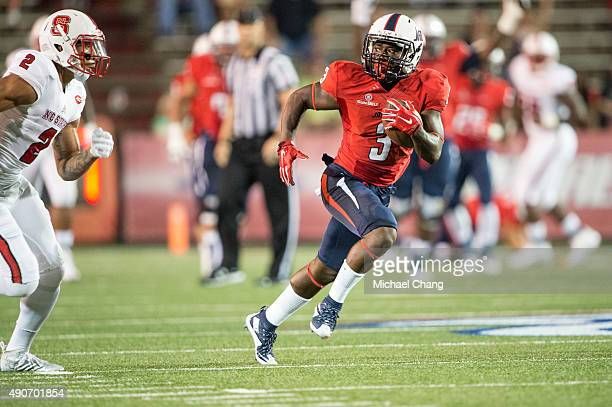 Wide receiver Chris Lewis of the South Alabama Jaguars looks to run the ball past safety Josh Jones of the North Carolina State Wolfpack on September...
