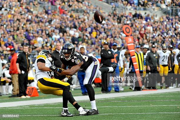Wide receiver Chris Matthews of the Baltimore Ravens fights for the ball with cornerback Ross Cockrell of the Pittsburgh Steelers during a game on...