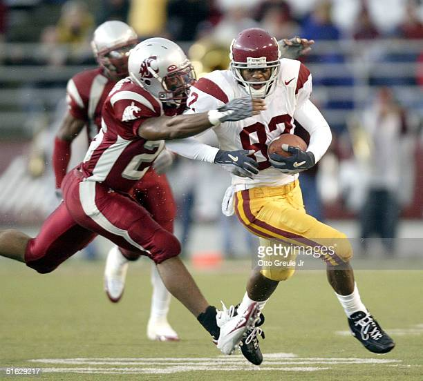 Wide Receiver Chris McFoy of the USC Trojans rushes against Jeremy Bohannon of the Washington State Cougars on November 30 2004 at Martin Stadium in...