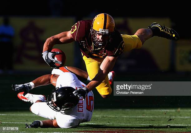 Wide receiver Chris McGaha of the Arizona State Sun Devils is brought down by Cameron Collins of the Oregon State Beavers after a 8 yard reception...