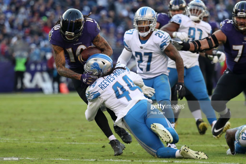 Wide Receiver Chris Moore #10 of the Baltimore Ravens is tackled by linebacker Jalen Reeves-Maybin #44 of the Detroit Lions in the fourth quarter at M&T Bank Stadium on December 3, 2017 in Baltimore, Maryland.