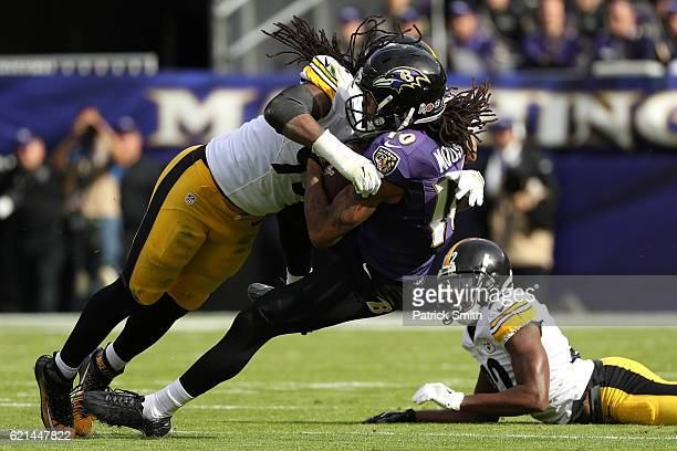 Wide receiver Chris Moore of the Baltimore Ravens is tackled by outside linebacker Jarvis Jones of the Pittsburgh Steelers in the first quarter at MT...