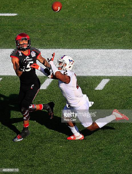 Wide receiver Chris Moore of the Cincinnati Bearcats catches a touchdown pass in front of cornerback Donovan Riley of the Virginia Tech Hokies during...