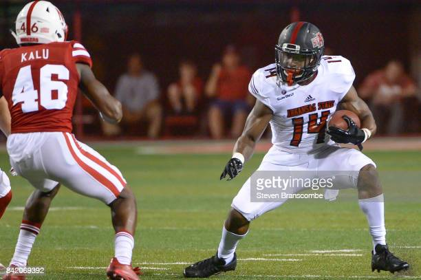 Wide receiver Chris Murray of the Arkansas State Red Wolves tries to avoid defensive back Joshua Kalu of the Nebraska Cornhuskers at Memorial Stadium...