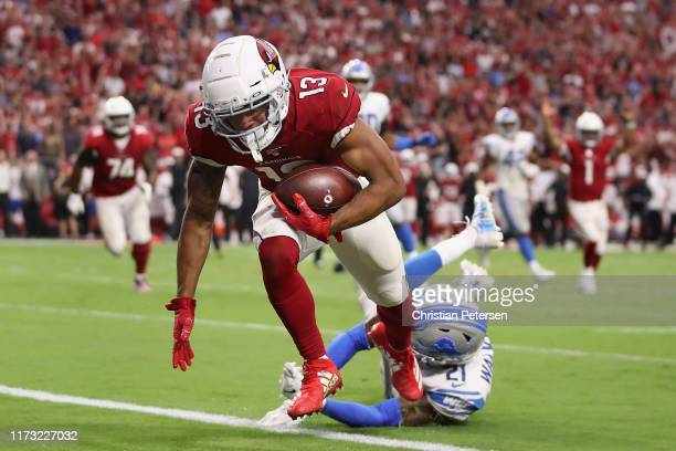 Wide receiver Christian Kirk of the Arizona Cardinals scores a two-point conversion past defensive back Tracy Walker of the Detroit Lions during the...