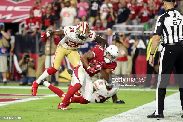 Wide receiver Christian Kirk of the Arizona Cardinals scores the game winning touchdown over cornerback Jimmie Ward and defensive back Tyvis Powell...