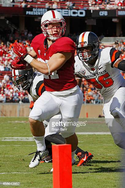 Wide receiver Christian McCaffrey of the Stanford Cardinal makes a 10yard catch against safety Ryan Murphy and defensive end Obum Gwacham of the...