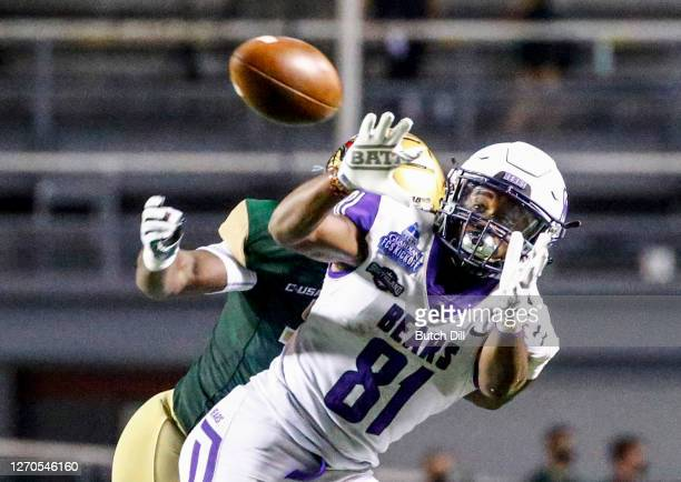 Wide receiver Christian Richmond of Central Arkansas catches a pass as safety Dy'jonn Turner of UAB defends during the second half of an NCAA college...
