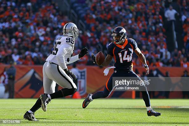 Wide receiver Cody Latimer of the Denver Broncos bobbles the ball on a rushing play as he is chased by defensive end Benson Mayowa of the Oakland...