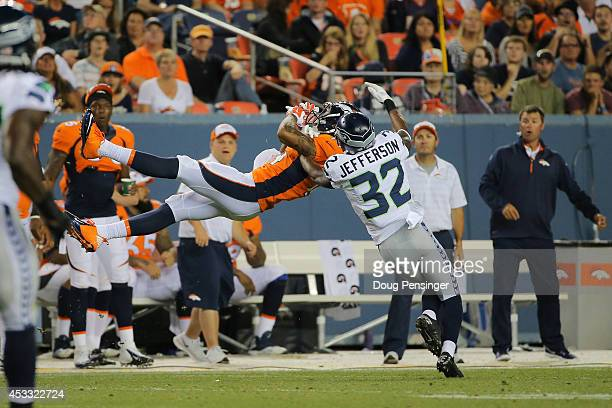 Wide receiver Cody Latimer of the Denver Broncos goes up for an attempted catch under coverage by cornerback AJ Jefferson of the Seattle Seahawks...