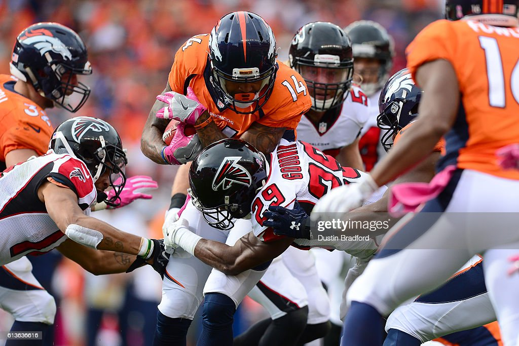 Wide receiver Cody Latimer #14 of the Denver Broncos is tackled by cornerback C.J. Goodwin #29 of the Atlanta Falcons in the first half of the game at Sports Authority Field at Mile High on October 9, 2016 in Denver, Colorado.