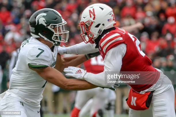 Wide receiver Cody White of the Michigan State Spartans and defensive back Lamar Jackson of the Nebraska Cornhuskers block at Memorial Stadium on...